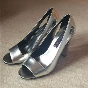 Silver open toe pumps